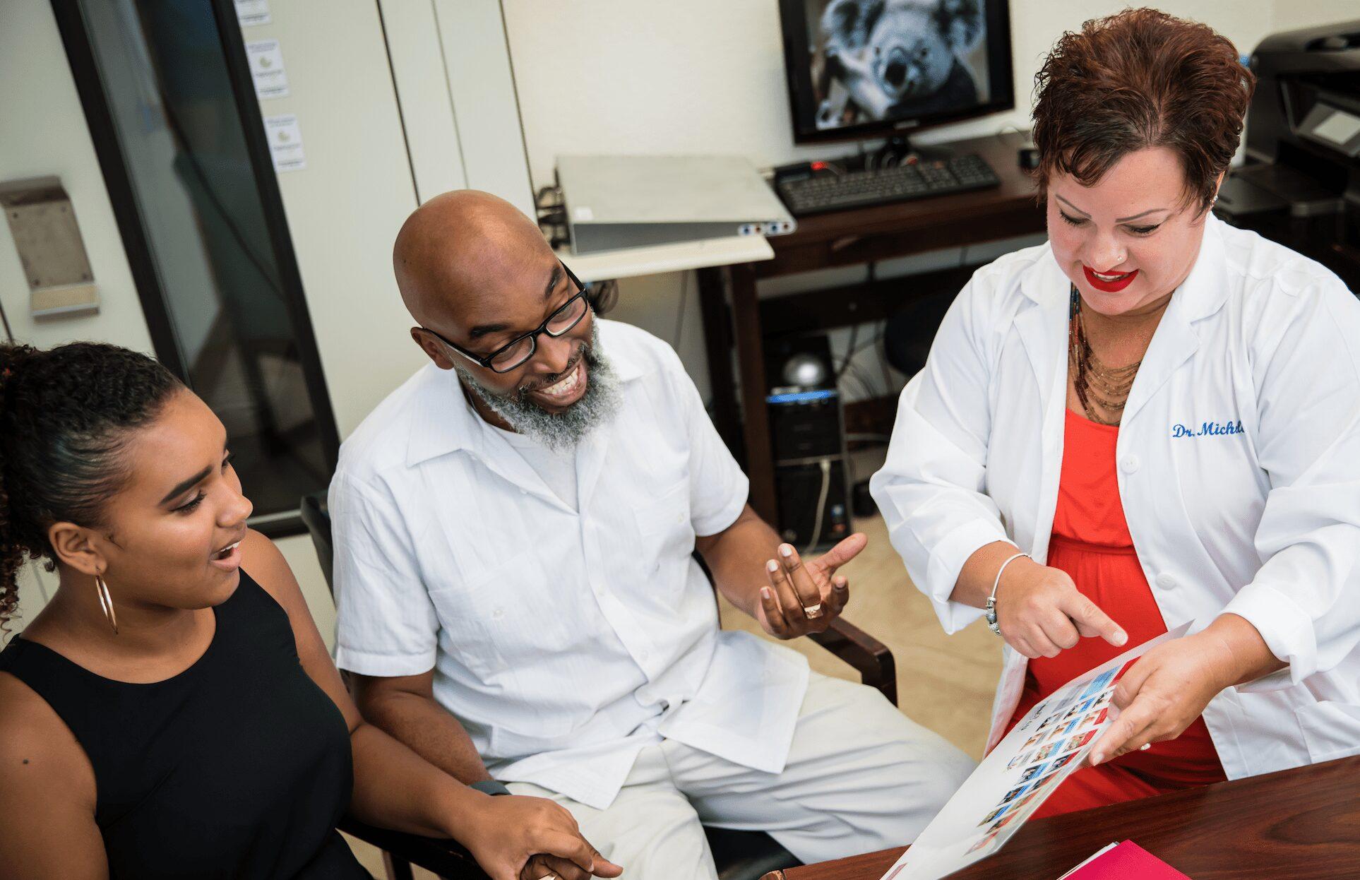 Dr. Michelle with patients | Dr Michelle